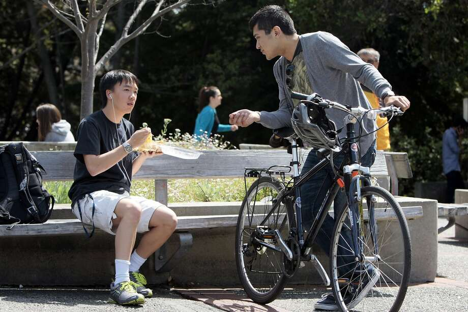 Sophomores Brandon Mah (left) and Christian Vazquez (right) talk while enjoying the sun at the UC Berkeley campus on April 18, 2014 in Berkeley, Calif. The UC system recently released data about its fall 2014 undergraduate admissions and there is an increase in the number of Latino students accepted. Photo: Codi Mills, The Chronicle