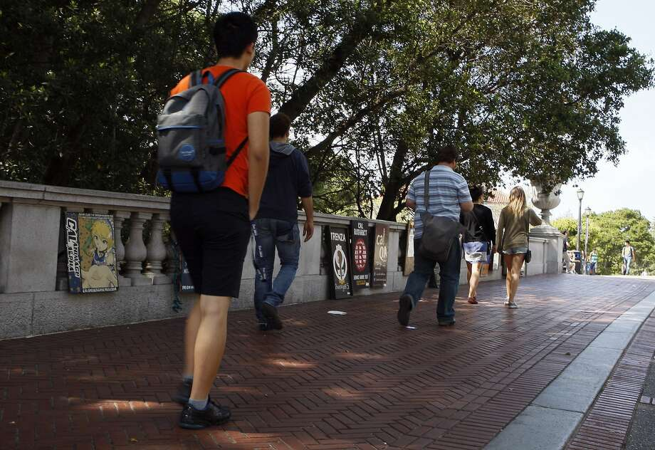 People walk past signs advertising various clubs to prospective students at the UC Berkeley campus on April 18, 2014 in Berkeley, Calif.  Photo: Codi Mills, The Chronicle