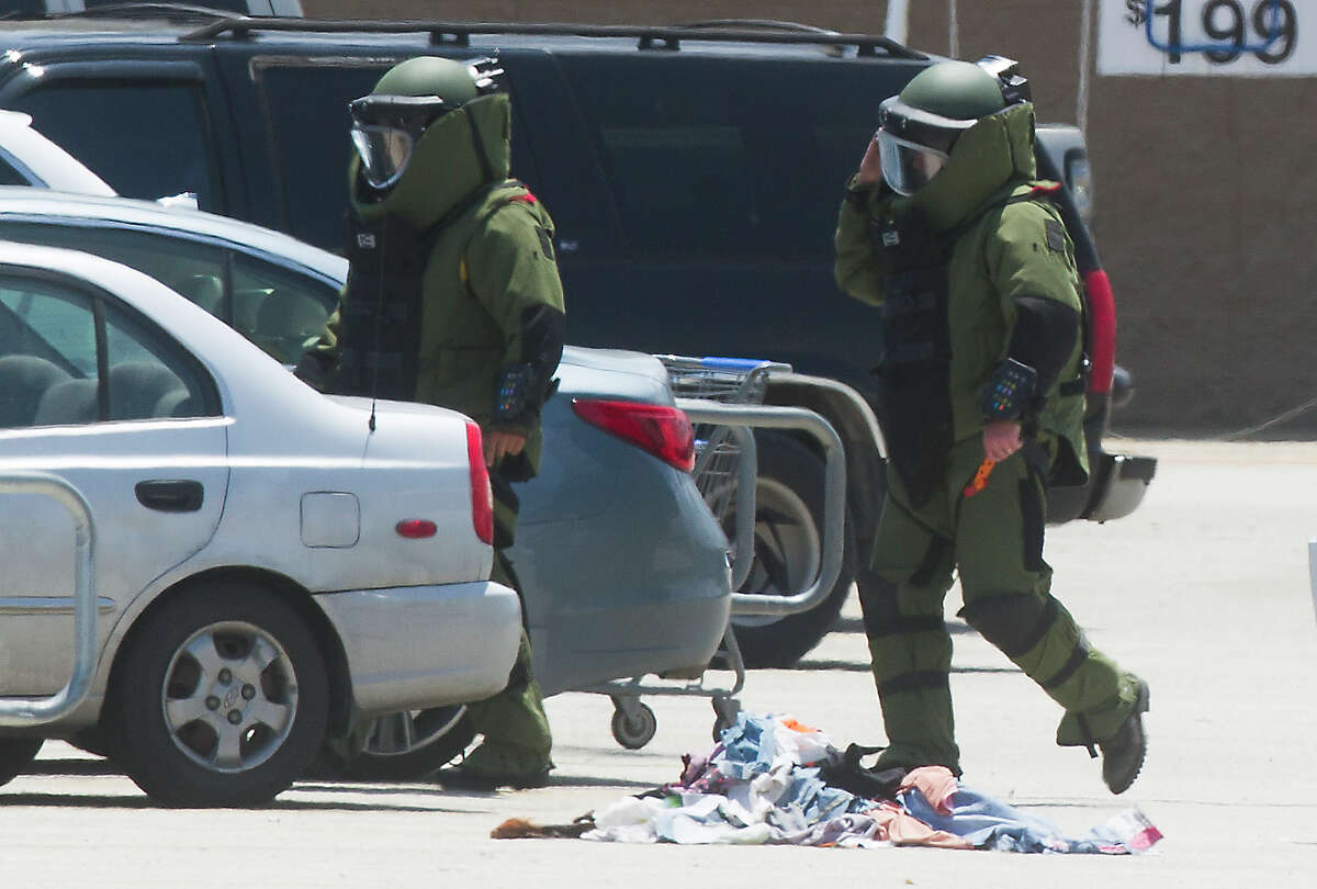 Police investigate a bomb threat at the Wal-Mart on Saturday, April 19, 2014, in Kemah.