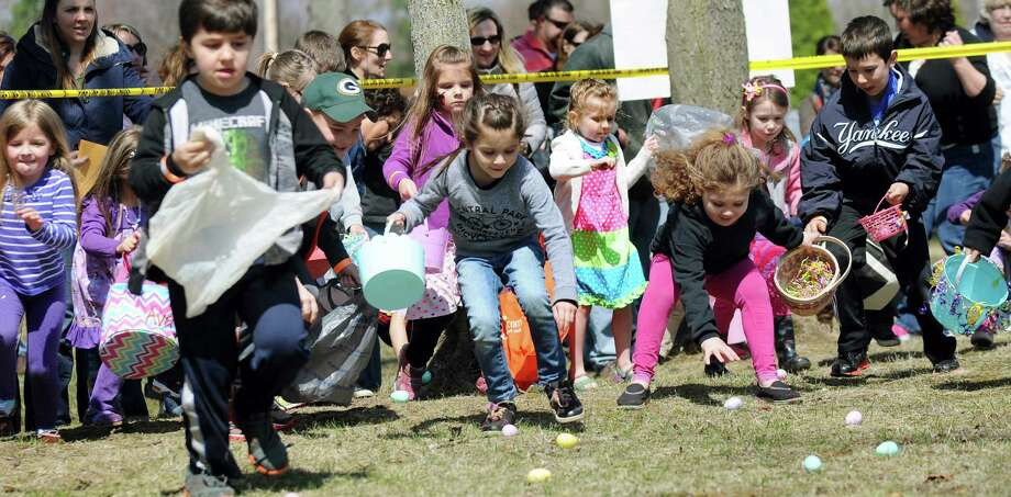 "Children in the 5- to 8-year-old age group rush to collect plastic eggs during the 3rd Annual ""Egg""cellent Easter Egg Hunt on Saturday, April 19, 2014, at the Midway Fire Department in Colonie, N.Y. (Cindy Schultz / Times Union) Photo: Cindy Schultz / 00026422A"