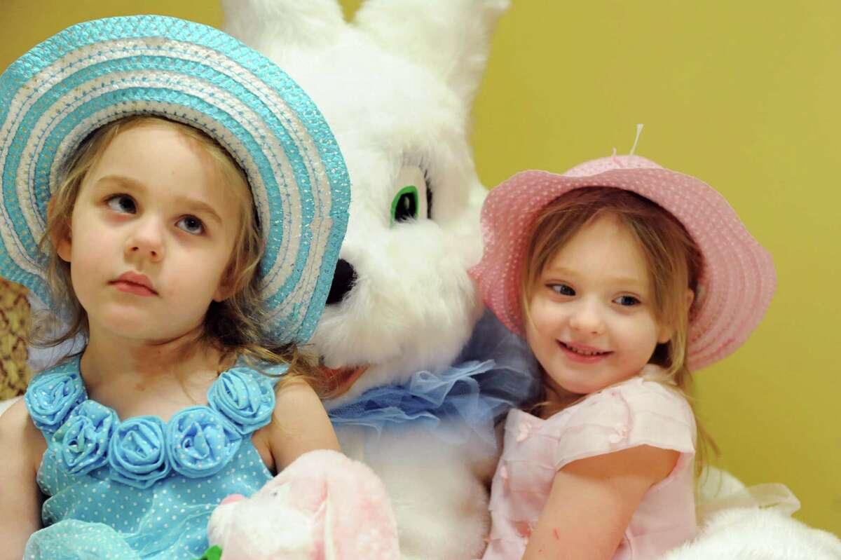 Cadylin Vroman, 3, left, and her twin sister, Elizabeth Vroman sit for a picture with the Easter Bunny on Saturday, April 19, 2014, at the Senior Citizens Center in Watervliet, N.Y. (Cindy Schultz / Times Union)