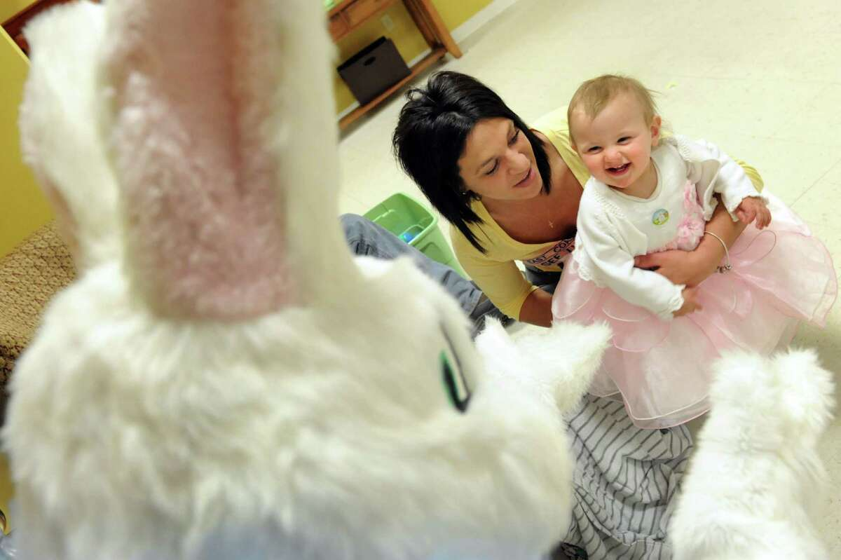Beige Sawyer, 10 months, right, delights in meeting the Easter Bunny on Saturday, April 19, 2014, at the Senior Citizens Center in Watervliet, N.Y. Joining Beige is her mother, Kelly Garrison. (Cindy Schultz / Times Union)