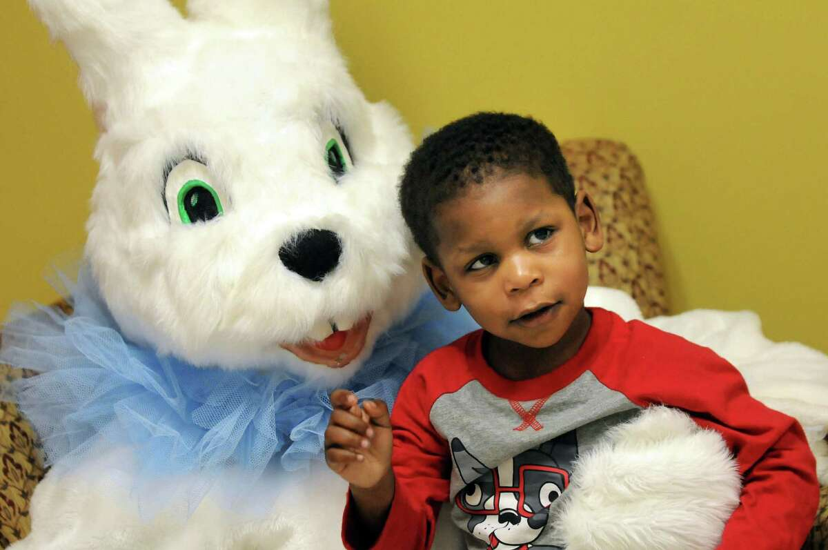 Nas'ir Barley, 2, of Watervliet sits for a picture with the Easter Bunny on Saturday, April 19, 2014, at the Senior Citizens Center in Watervliet, N.Y. (Cindy Schultz / Times Union)