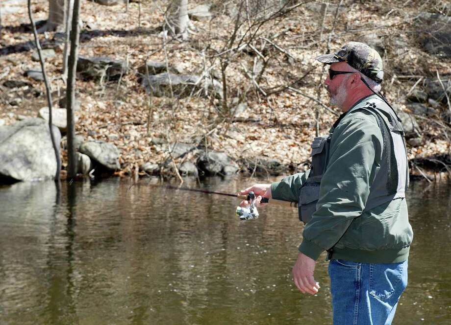 Joe Finateri of White Plains fishes in the Mianus River on the Stamford and Greenwich border on Saturday, April 19, 2014, the opening day of trout season. Photo: Lindsay Perry / Stamford Advocate