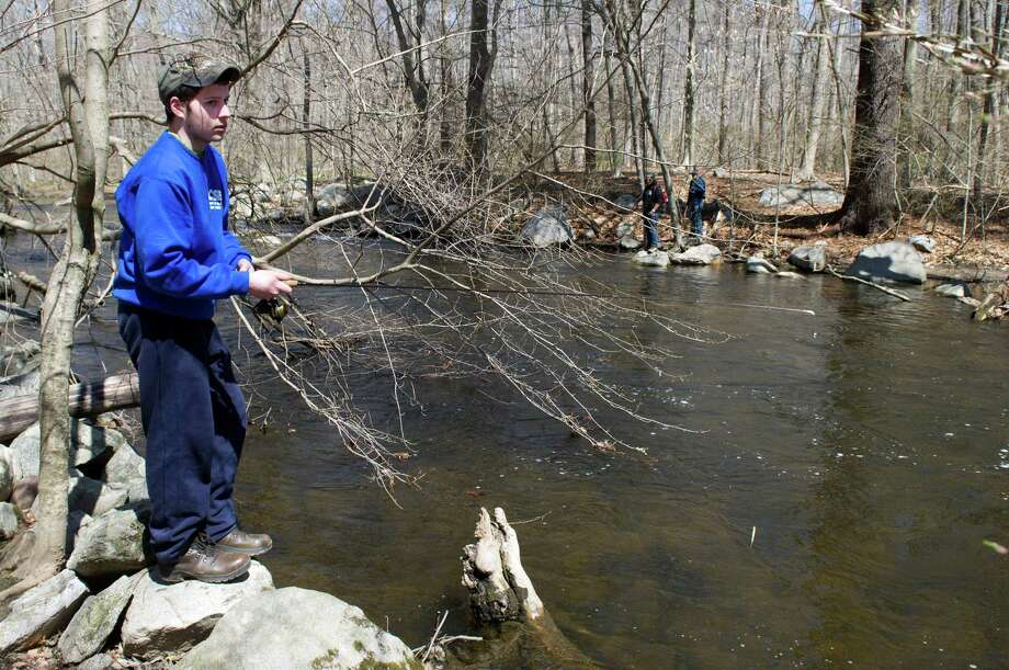John Finateri, 17, of White Plains fishes in the Mianus River on the Stamford and Greenwich border on Saturday, April 19, 2014, the opening day of trout season. Photo: Lindsay Perry / Stamford Advocate