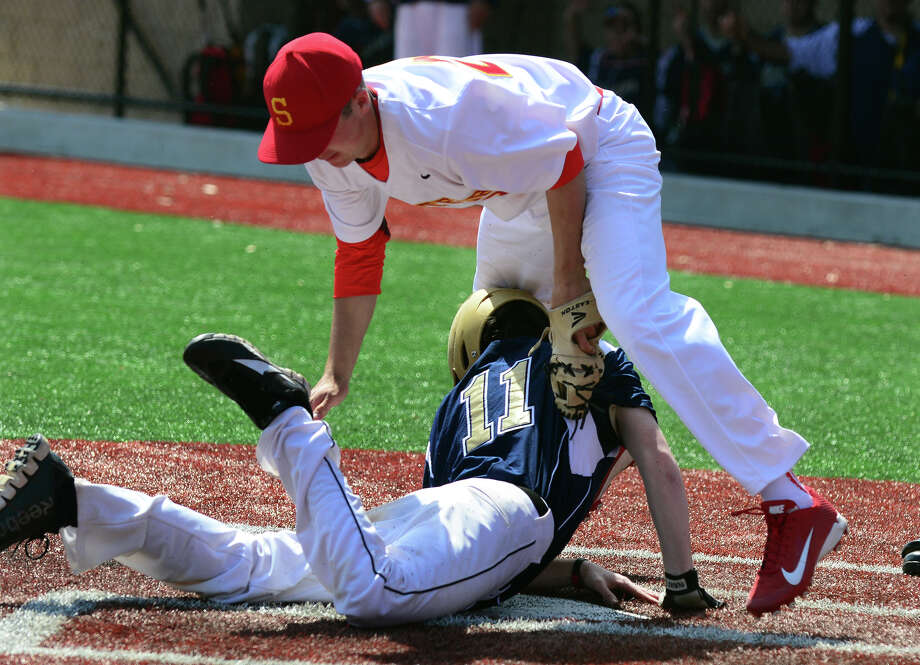 Stratford pitcher Jack Duffy tags out Notre Dame of Fairfield's Matt Coppole at home plate, during baseball action at Pender's Field in Stratford, Conn. on Saturday April 19, 2014. Photo: Christian Abraham / Connecticut Post