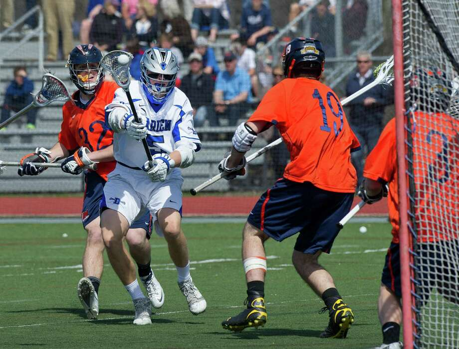 Darien's Harry Gillespie takes a shot during Saturday's boys lacrosse game against Manhassett in Darien, Conn., on April 19, 2014. Photo: Lindsay Perry / Stamford Advocate