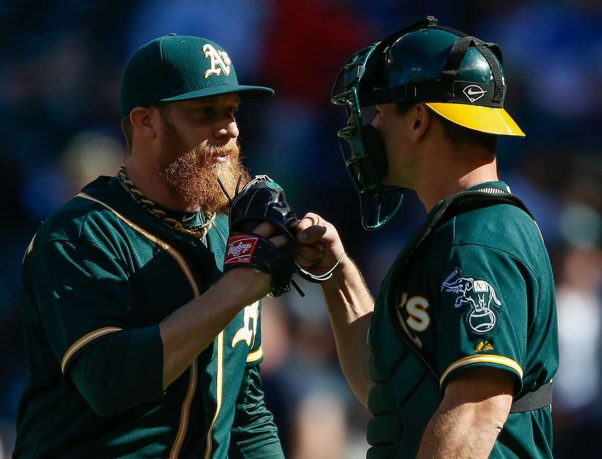 SEATTLE, WA - APRIL 13: Relief pitcher Sean Doolittle #62 (L) of the Oakland Athletics celebrates with catcher John Jaso #5 after defeating the Seattle Mariners 3-0 at Safeco Field on April 13, 2014 in Seattle, Washington. (Photo by Otto Greule Jr/Getty Images)