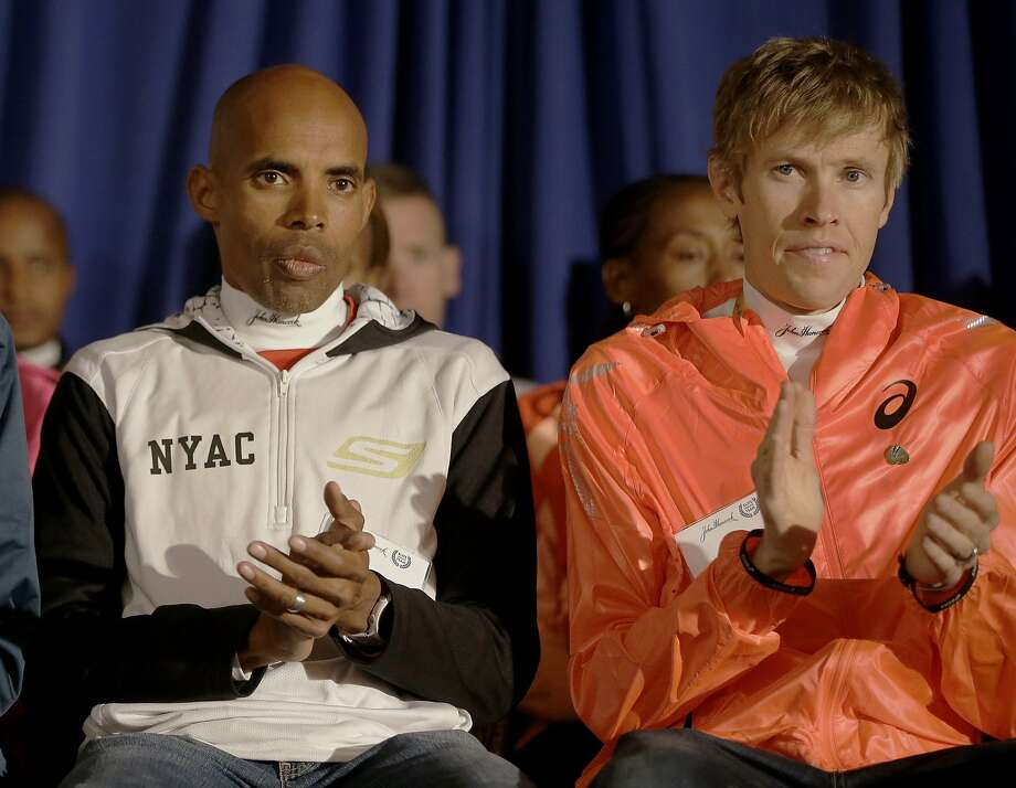 Olympians Meb Keflezighi (left) and Redding's Ryan Hall are part of a strong field of men and women who will try to become the first American to win the Boston Marathon since the 1980s. Photo: Stephan Savoia, Associated Press