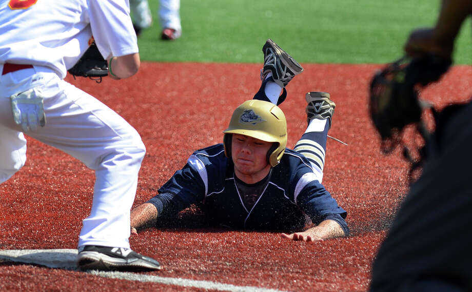 Notre Dame of Fairfield's Brendan Barger slides into third, during baseball action against Stratford at Penders Field in Stratford, Conn. on Saturday April 19, 2014. Photo: Christian Abraham / Connecticut Post