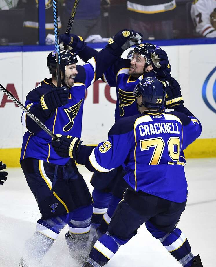 Blues defenseman Barret Jackman (left) is congratulated after scoring the overtime winner against the Blackhawks in St. Louis. Photo: Scott Rovak, Reuters