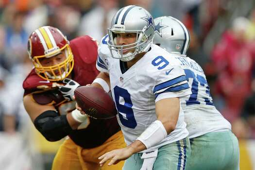 Dallas Cowboys quarterback Tony Romo scrambles out of the pocket during the second half of an NFL football game against the Washington Redskins in Landover, Md., Sunday, Dec. 22, 2013. (AP Photo/Evan Vucci) Photo: Evan Vucci, Associated Press / AP