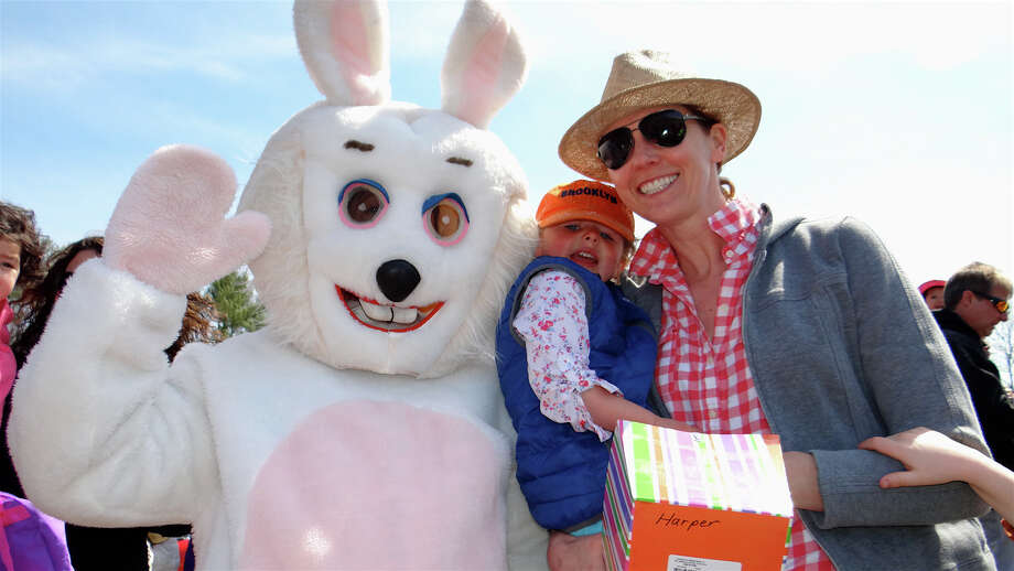 Donielle Hawley of Westport and daughter, Harper, 3, with the Easter Bunny at Greens Farms Volunteer Fire Company's Easter Egg Hunt at Long Lots School on Saturday afternoon. Photo: Mike Lauterborn / Westport News