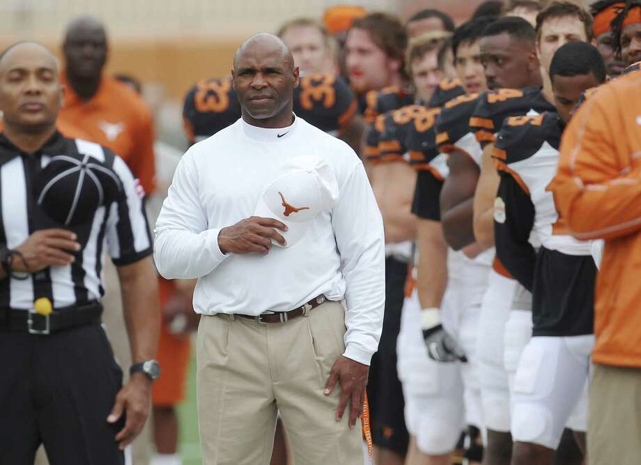 New Texas Longhorn Head Football Coach Charlie Strong stands at attention for the National Anthem before the 2014 Texas Football Orange-White Scrimmage in Austin on Saturday, Apr. 19, 2014. Photo: Kin Man Hui, San Antonio Express-News / ©2014 San Antonio Express-News