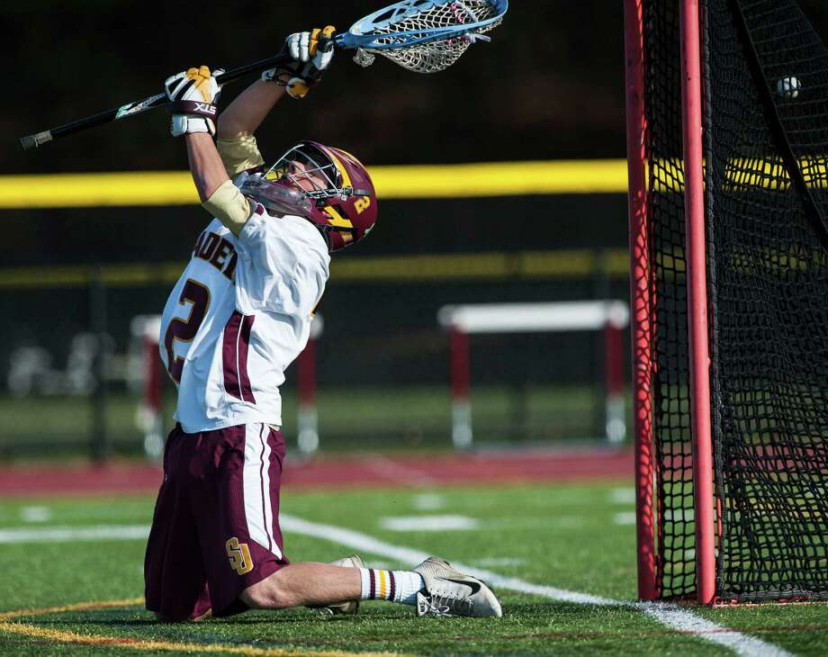 A shot gets by St Joseph high school goalie Mike Braddick during a boy's lacrosse game against Greenwich high school played at St Joseph high school, Trumbull, CT on Saturday, April, 19th, 2014. Photo: Mark Conrad / Connecticut Post Freelance