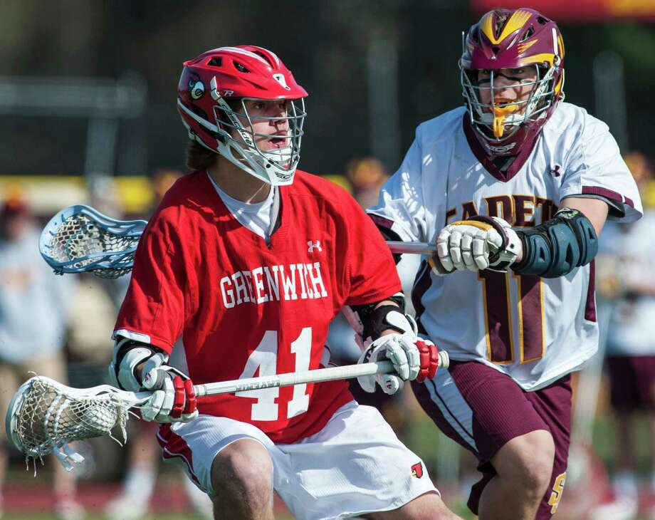 Greenwich high school's Decker Curran tries to get around St Joseph high school defenseman Ryan Corcoran during a boy's lacrosse game played at St Joseph high school, Trumbull, CT on Saturday, April, 19th, 2014. Photo: Mark Conrad / Connecticut Post Freelance