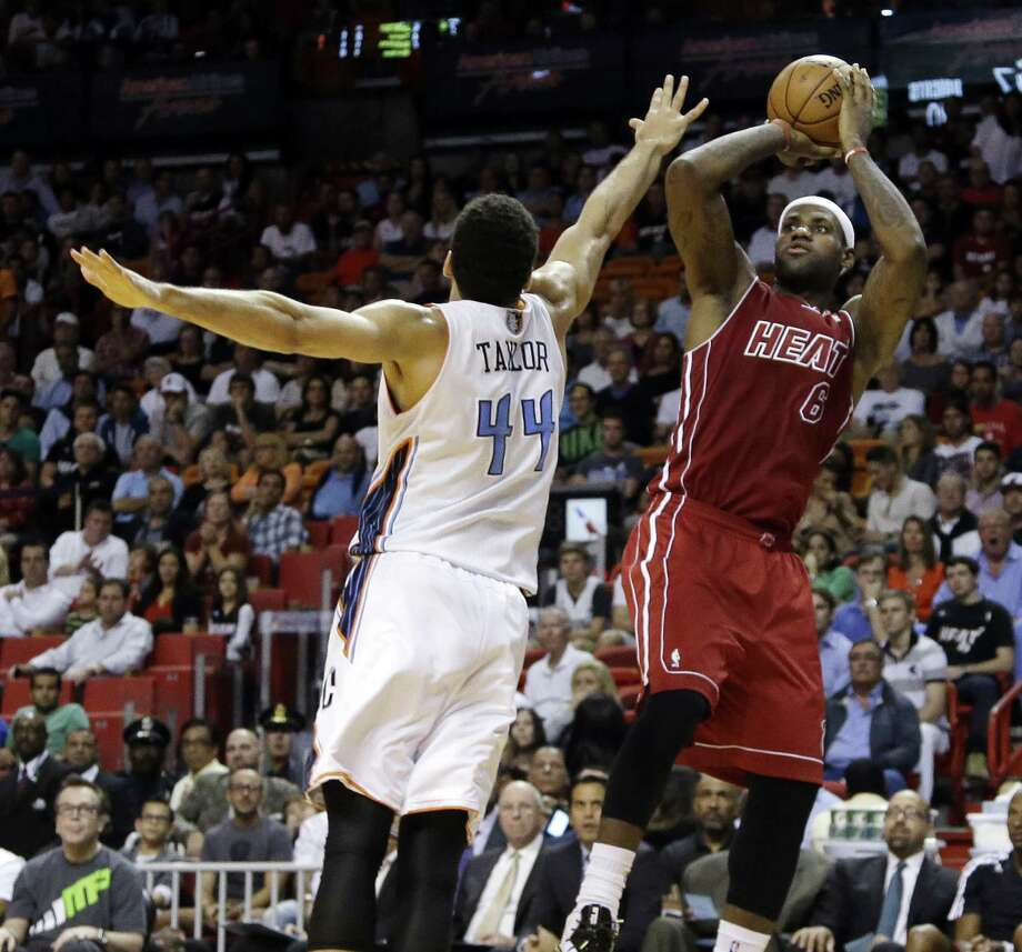 Heat forward LeBron James (right) scored 61 points in a game against Jeff Taylor and the Bobcats earlier this season. Photo: Lynne Sladky / Associated Press / AP