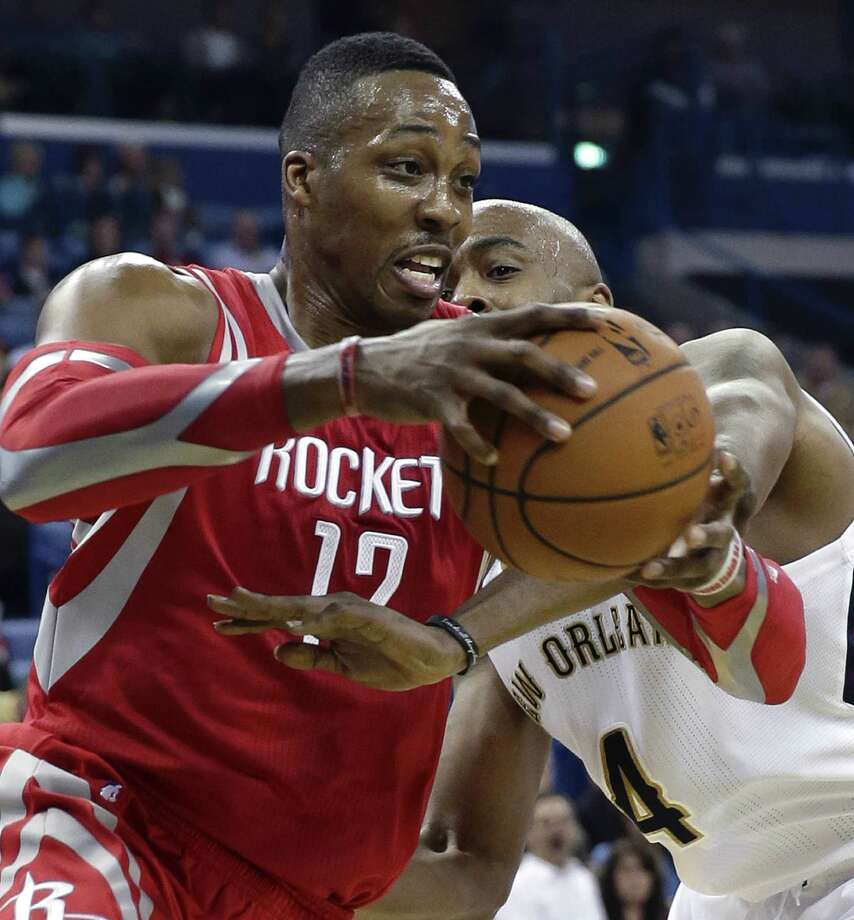 "Center Dwight Howard (left) says what sealed his decision to sign with Houston last summer was how much the Rockets want to win a title. ""That's what enticed me,"" he said. Photo: Gerald Herbert / Associated Press / AP"