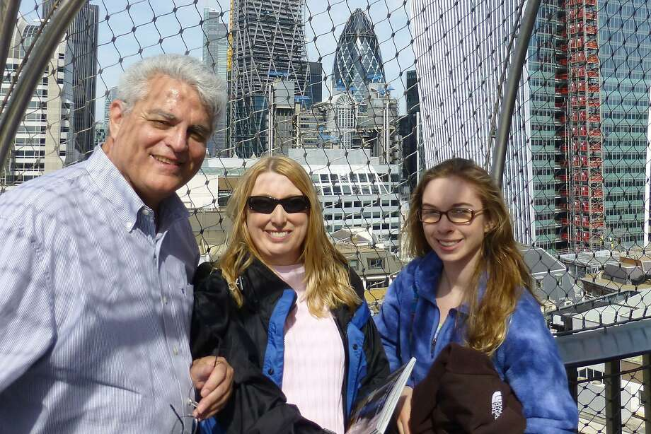 Bob and Courtney Morehen with Audrey Moore at the Gherkin Building and soon to be completed Walkie Talkie Tower from atop the London Monument. Photo: Courtesy Courtney Morehen