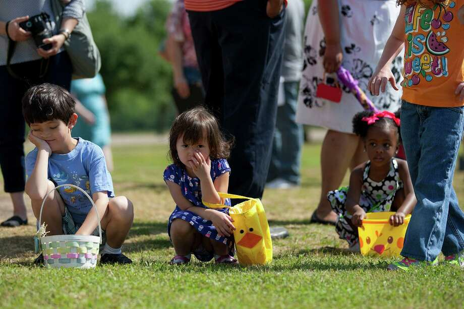 Connor McCain, 7, and his sister Kaitlyn, 3, wait with other children before chasing down eggs in an old-fashioned Easter egg hunt outside the 1860s Ryon Prairie Home at the George Ranch Historical Park Saturday, April 19, 2014, in Houston. Children were able to step back in time and play games popular in the 1800s and decorate eggs. Photo: Johnny Hanson, Houston Chronicle / © 2014  Houston Chronicle