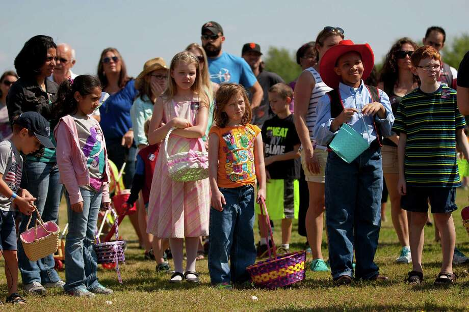 Children wait before being set loose to chase down eggs in an old-fashioned Easter egg hunt outside  the 1860s Ryon Prairie Home at the George Ranch Historical Park Saturday, April 19, 2014, in Houston. Children were able to step back in time and play games popular in the 1800s and decorate eggs. Photo: Johnny Hanson, Houston Chronicle / © 2014  Houston Chronicle
