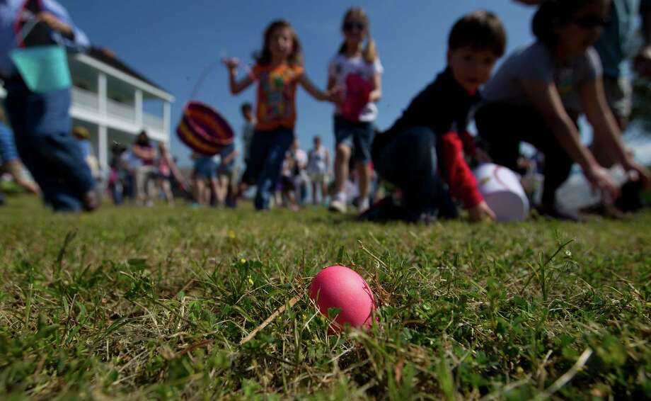 Children search for eggs in an old-fashioned Easter egg hunt at the 1860s Ryon Prairie Home at the George Ranch Historical Park Saturday, April 19, 2014, in Houston. Children were able to step back in time and play games popular in the 1800s and decorate eggs. Photo: Johnny Hanson, Houston Chronicle / © 2014  Houston Chronicle