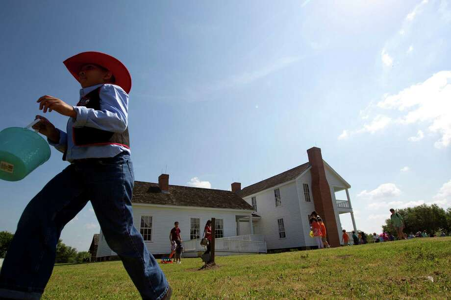 Joshua Johnson, 9, searches for eggs in an old-fashioned Easter egg hunt outside the 1860s Ryon Prairie Home at the George Ranch Historical Park Saturday, April 19, 2014, in Houston. Children were able to step back in time and play games popular in the 1800s and decorate eggs. Photo: Johnny Hanson, Houston Chronicle / © 2014  Houston Chronicle