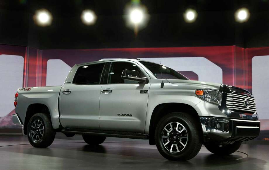 In this Thursday, Feb. 7, 2013, file photo, the redesigned 2014 Toyota Tundra is unveiled at the Chicago Auto Show, 2013, in Chicago. In its first major update since 2007, the full-size Toyota Tundra pickup truck is redesigned with a bold, American-style exterior, a refined, quieter interior and standard backup camera and Bluetooth phone and audio connectivity.   (AP Photo/Charles Rex Arbogast, File) Photo: Associated Press / AP