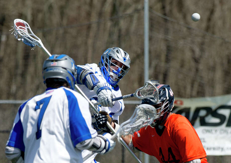 Darien's Colin Minicus takes a shot during Saturday's boys lacrosse game against Manhassett in Darien, Conn., on April 19, 2014. Photo: Lindsay Perry / Stamford Advocate