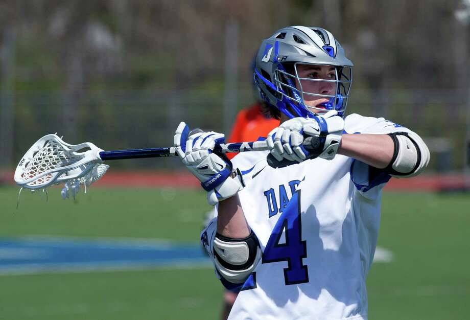 Darien's Jack Kniffen controls the ball during Saturday's boys lacrosse game against Manhassett in Darien, Conn., on April 19, 2014. Photo: Lindsay Perry / Stamford Advocate
