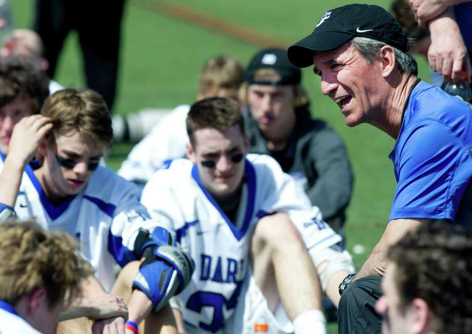 Darien coach Jeff Brameier talks to his team during Saturday's boys lacrosse game against Manhassett in Darien, Conn., on April 19, 2014. Photo: Lindsay Perry / Stamford Advocate