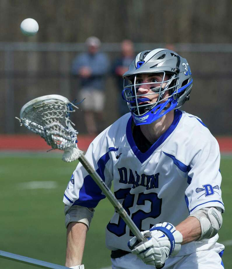 Darien's Ian Burgoyne controls the ball during Saturday's boys lacrosse game against Manhassett in Darien, Conn., on April 19, 2014. Photo: Lindsay Perry / Stamford Advocate