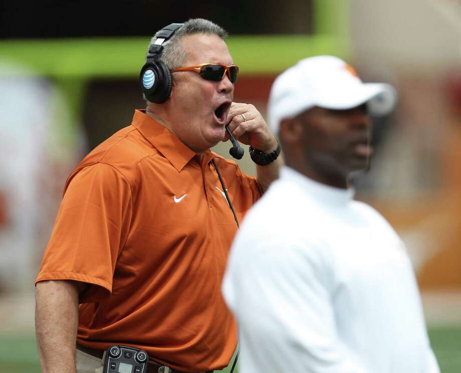 Texas Longhorn Offensive Coordinator Joe Wickline calls out to players on the field during the 2014 Texas Football Orange-White Scrimmage in Austin on Saturday, Apr. 19, 2014. Photo: Kin Man Hui, San Antonio Express-News / ©2014 San Antonio Express-News