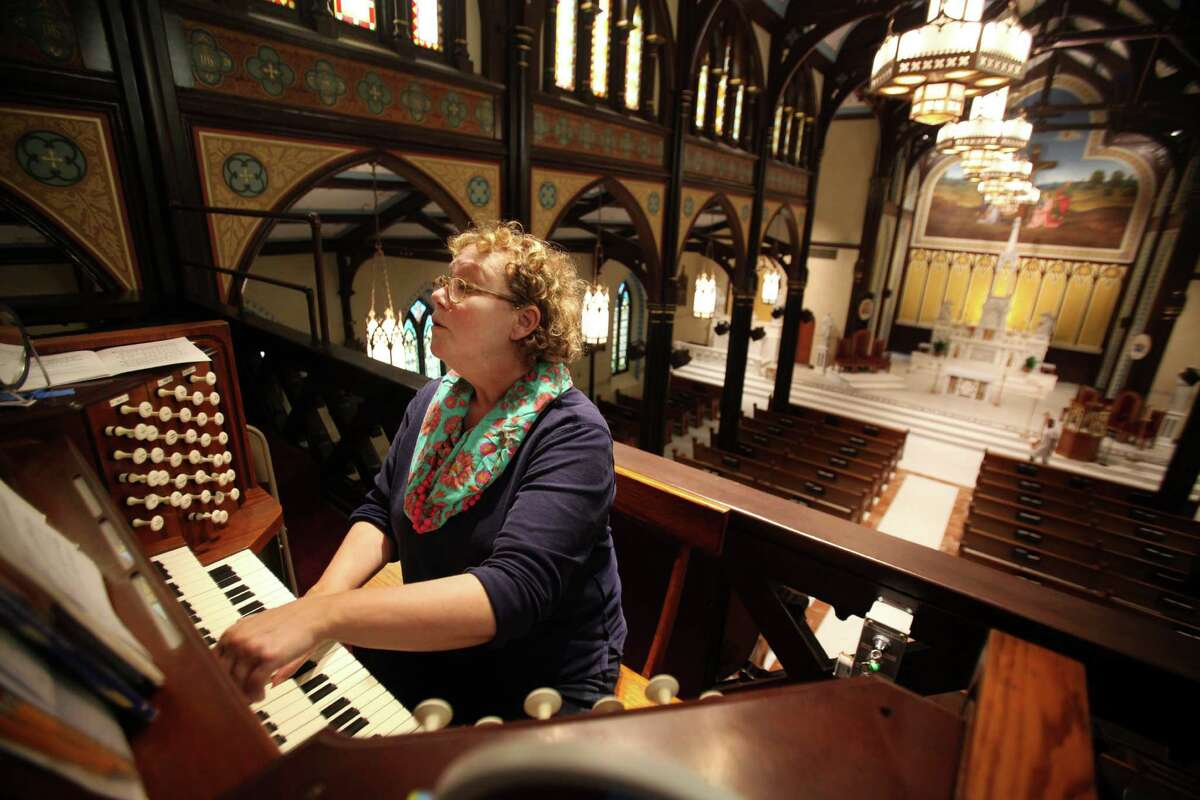 Music Director Deborah Lewis rehearses with the organ in preparation for Easter Sunday Mass at St. Mary Cathedral Basilica on April 17, 2014, in Galveston, Tx.