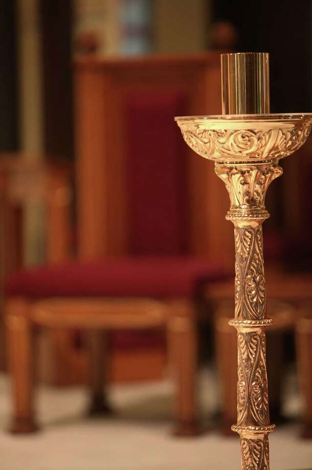 Ornate candle holders surround the alter inside the newly restored St. Mary Cathedral Basilica on April 17, 2014, in Galveston, Tx. Photo: Mayra Beltran, Houston Chronicle / © 2014 Houston Chronicle