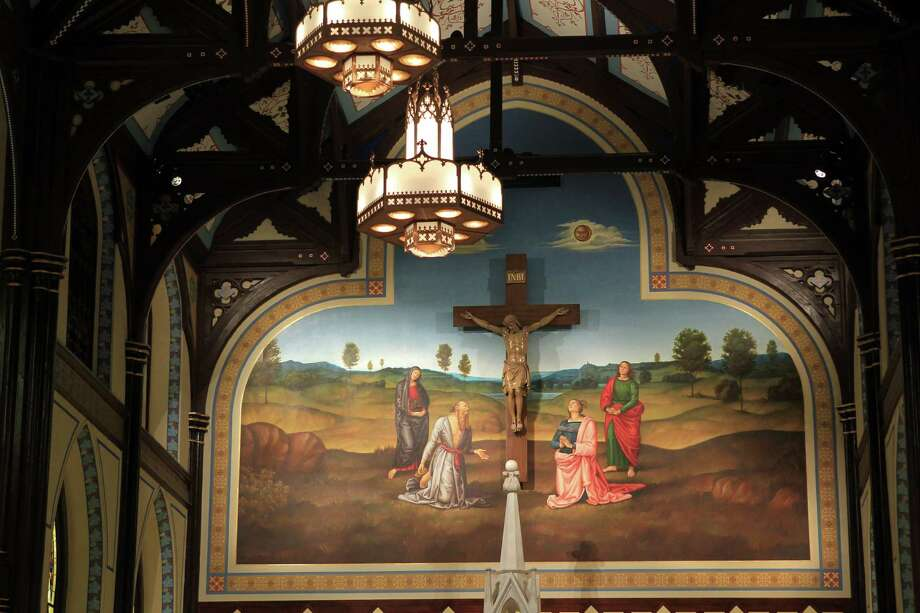 The art surrounding the Crucifix is based on Citta di Castello altarpiece, by the artist Raphael, which depicts Blessed Virgin Mary standing at the foot of the cross, with Saint John the Evangelist. Kneeling on the right is Saint Mary Magdalene and on the left is Saint Jerome. The newly restored St. Mary Cathedral Basilica on April 17, 2014, in Galveston, Tx. Photo: Mayra Beltran, Houston Chronicle / © 2014 Houston Chronicle