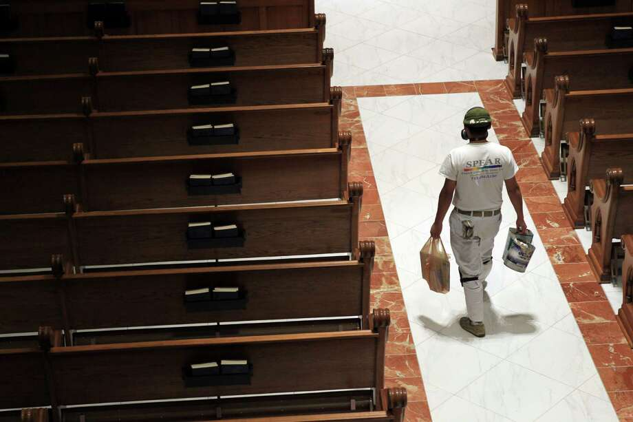 The wooden floor was pulled out and tile was replaced throughout the church during its restoration. The church will reopen for Easter Sunday Mass at St. Mary Cathedral Basilica on April 17, 2014, in Galveston, Tx. Photo: Mayra Beltran, Houston Chronicle / © 2014 Houston Chronicle