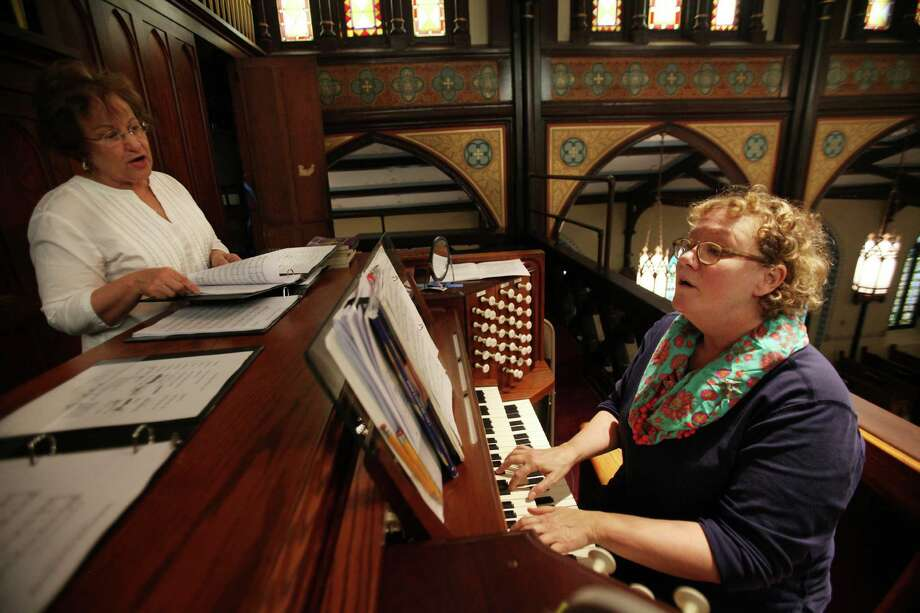 Darnell Russo and Music Director Deborah Lewis rehearse with organ in preparation for Easter Sunday Mass at St. Mary Cathedral Basilica on April 17, 2014, in Galveston, Tx. Photo: Mayra Beltran, Houston Chronicle / © 2014 Houston Chronicle