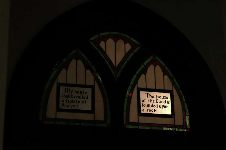 The light highlights a saying worked into the stain glass window at St. Mary Cathedral Basilica which will reopen Easter Sunday on April 17, 2014, in Galveston, Tx. Photo: Mayra Beltran, Houston Chronicle / © 2014 Houston Chronicle