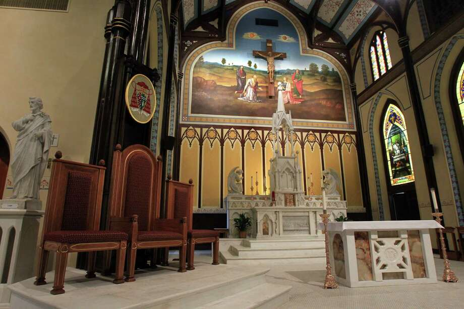The art surrounding the Crucifix is based on Citta di Castello altarpiece, by the artist Raphael, inside the newly restored St. Mary Cathedral Basilica on April 17, 2014, in Galveston, Tx. Photo: Mayra Beltran, Houston Chronicle / © 2014 Houston Chronicle
