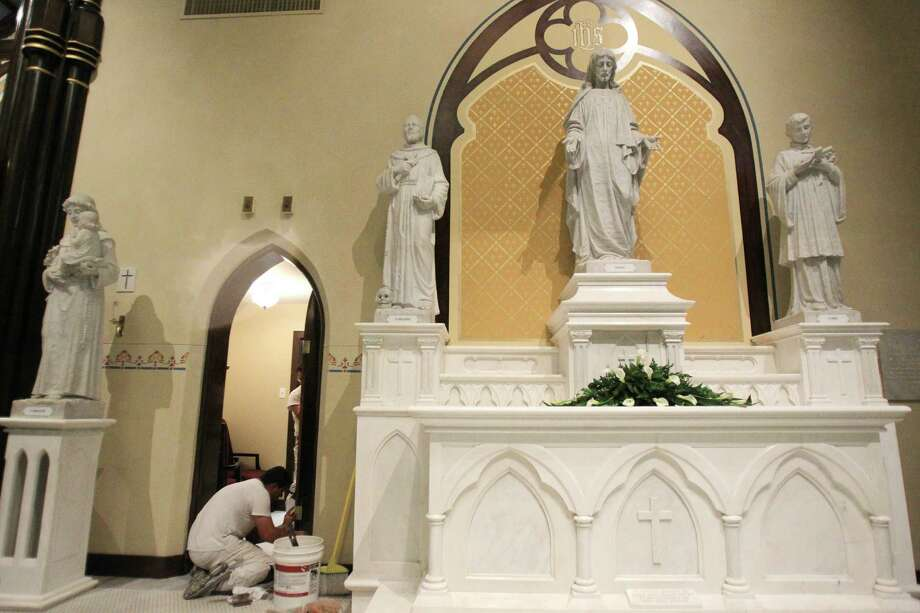 Work crews add finishing touches in preparation for Easter Sunday Mass in the newly restored St. Mary Cathedral Basilica on April 17, 2014, in Galveston, Tx. Photo: Mayra Beltran, Houston Chronicle / © 2014 Houston Chronicle