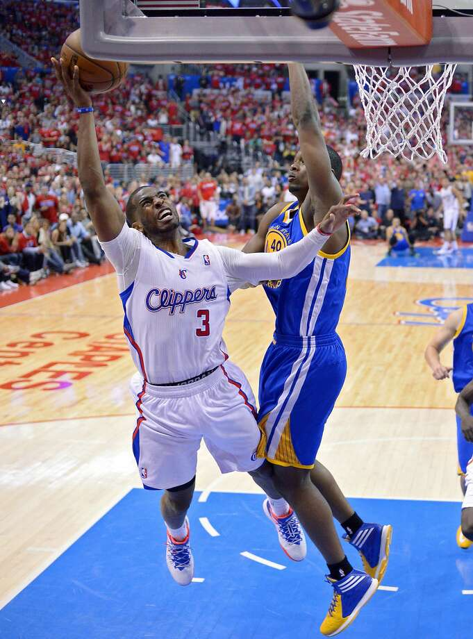 Chris Paul (3) tries to evade Harrison Barnes, who had a big block of Paul's shot near the finish. Photo: Mark J. Terrill, Associated Press