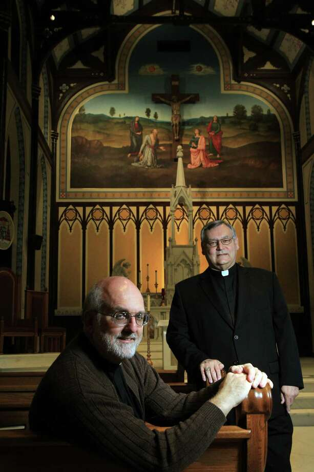 Father E.J. Stein and project manager Father Joseph Limanni are photographed in the completed St. Mary Cathedral Basilica which will reopen Easter Sunday on April 17, 2014, in Galveston, Tx. Photo: Mayra Beltran, Houston Chronicle / © 2014 Houston Chronicle
