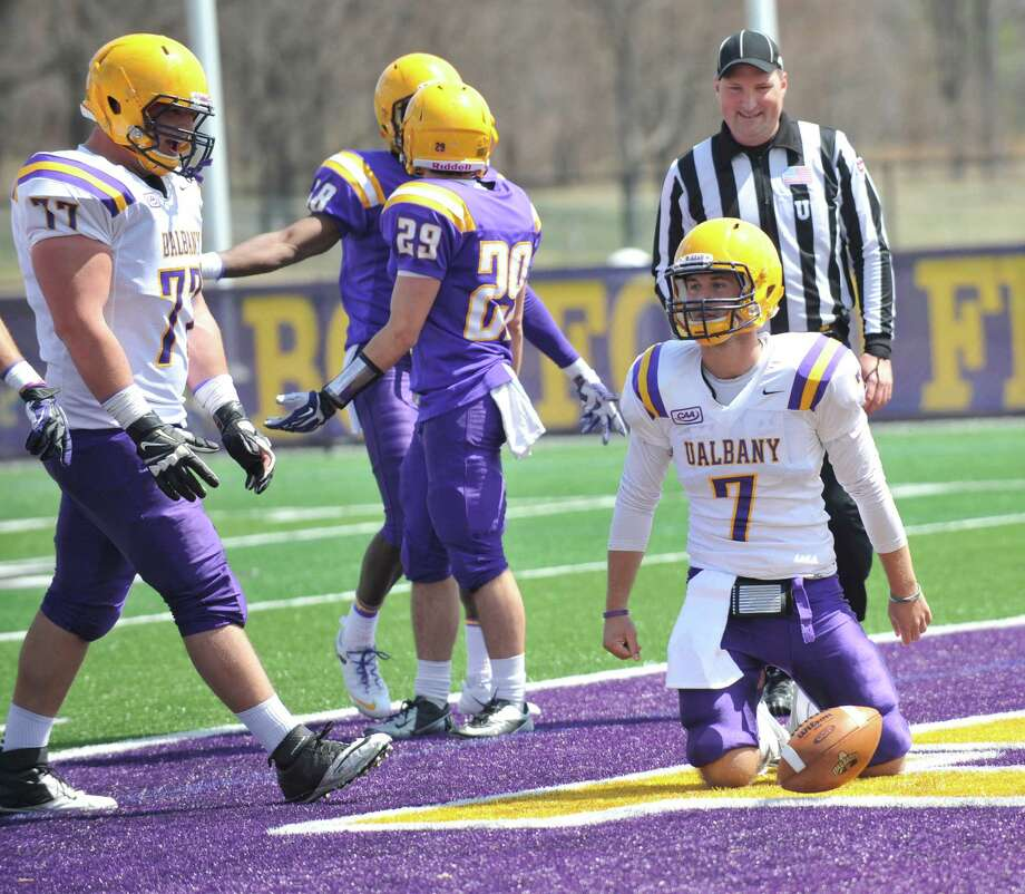 Quarterback Ryan Smith (7) reacts after scoring a touchdown during second half of UAlbany's Purple-White spring NCAA college football game on Saturday, April 19, 2014, in Albany, N.Y., (Hans Pennink) ORG XMIT: HP Photo: HANS PENNINK