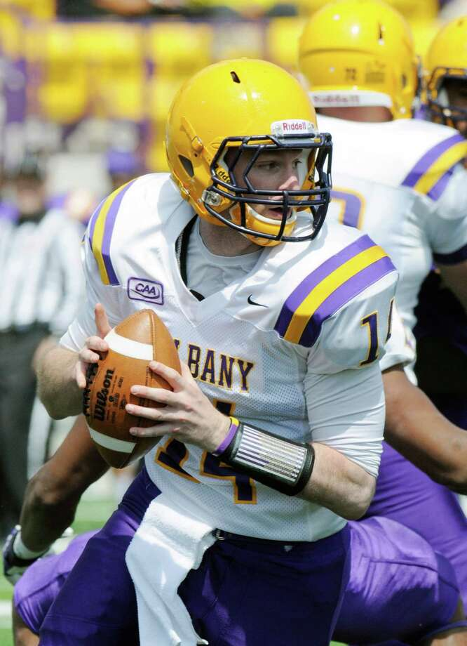 Quarterback Will Fiacchi (14) scrambles with the ball during the first half of UAlbany's Purple-White spring NCAA college football game on Saturday, April 19, 2014, in Albany, N.Y., (Hans Pennink) ORG XMIT: HP110 Photo: HANS PENNINK