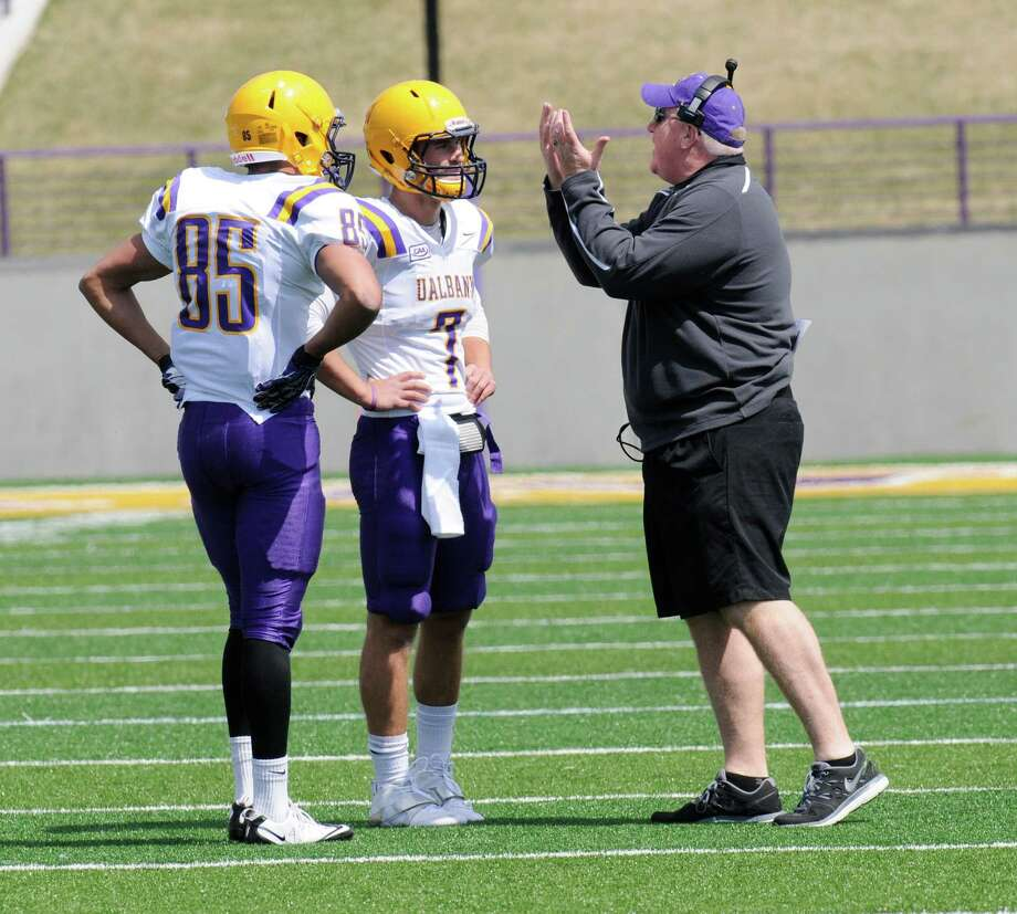 Ualbany head coach Greg Gattuso (right) talks with Wide Receiver Brad Harris (85) and quarterback Ryan Smith (7) during the first half of the Purple-White spring NCAA college football game on Saturday, April 19, 2014, in Albany, N.Y., (Hans Pennink) ORG XMIT: HP112 Photo: HANS PENNINK