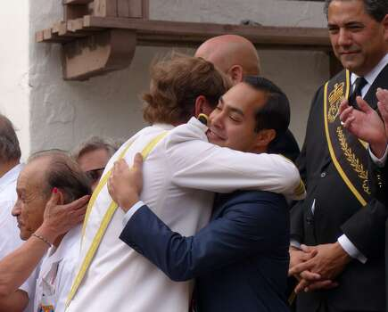 Rey Feo LXVI Jimmy Green embraces Mayor Julian Castro during his crowning ceremony at the Arneson River Theatre on Saturday, April 19, 2014. Photo: Billy Calzada, San Antonio Express-News /  San Antonio Express-News