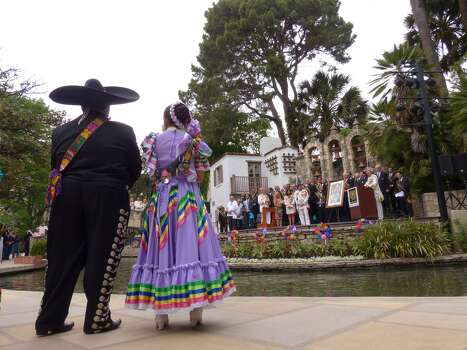Folklorico dancers listen during the crowning ceremony of Rey Feo LXVI Jimmy Green at the Arneson River Theatre on Saturday, April 19, 2014. Photo: Billy Calzada, San Antonio Express-News /  San Antonio Express-News