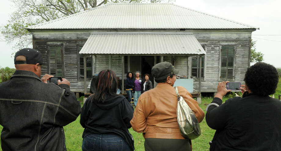 Family members explore the property that was formerly part of the Foley plantation in Hallettsville. Photo: Jerry Baker, For The Chronicle