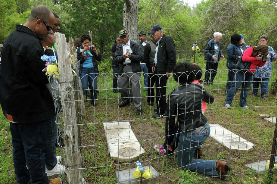Family members visit the Foley Cemetery in Hallettsville. Photo: Jerry Baker, For The Chronicle